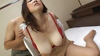 Take charge Japanese babe lays on the bed and moans during fucking