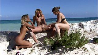 Hot lesbian Tarra White enjoys a threesome with strangers on the beach
