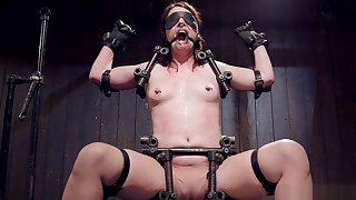Brunette is bound in metal chair device