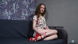Sexy red haired housewife Milena Tissen is toying wet pussy