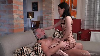 Skinny young brunette acts medial with her senior male servant